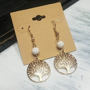 White lava rock goldtone tree of life earrings